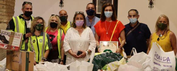 Caballeros del Asfalto dona a Solidarios en Ronda más de 250 kilos de alimentos